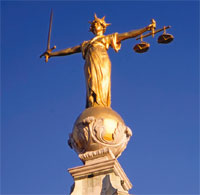 The Old Bailey law courts statue image