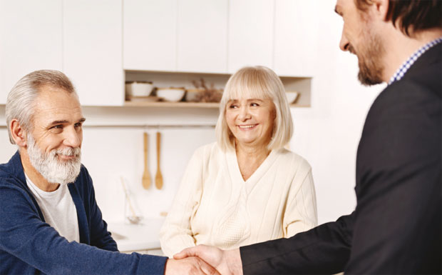 Agent shaking hands with client image