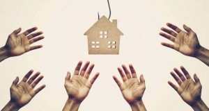 Hands outstretched to house image
