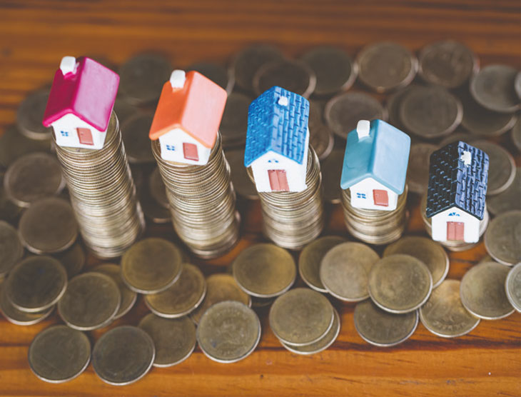 Houses on stacks of money image
