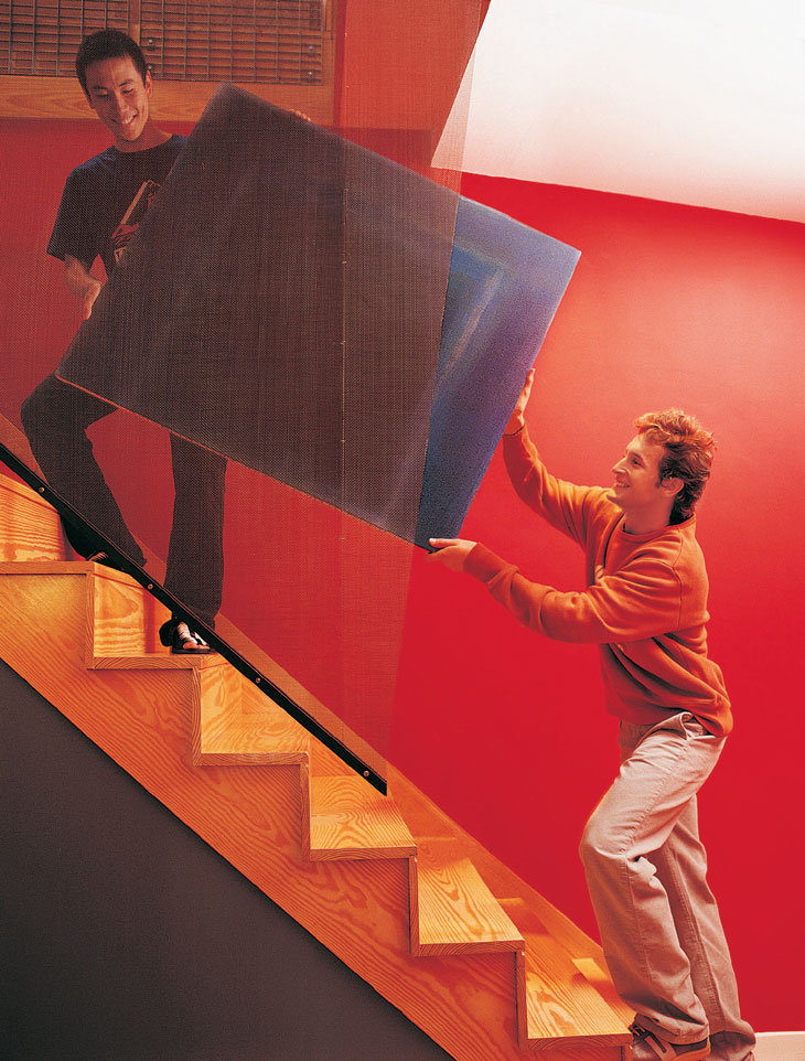 Tenants moving furniture on stairs image