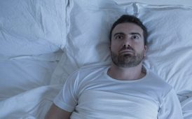 Man awake in bed image