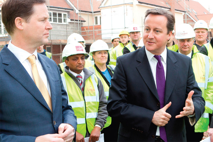 David Cameron with builders image