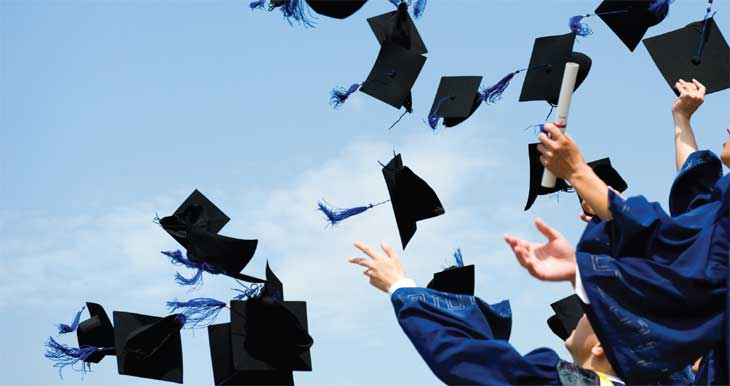 graduates throwing hats image