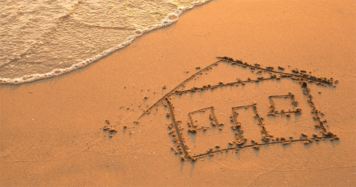 house in the sand image